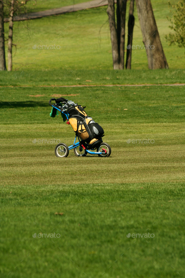 Golf bag on the fairway of a course - Stock Photo - Images