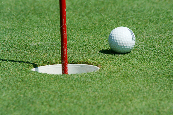 Golf ball near the cup - Stock Photo - Images