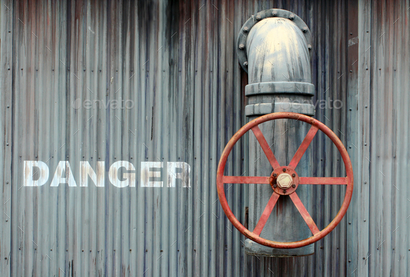 Large wheel valve with danger - Stock Photo - Images