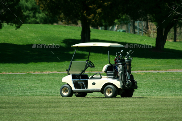 Golf cart on the fairway of a course - Stock Photo - Images