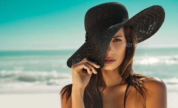 Fashion woman with straw hat at beach - Stock Photo - Images