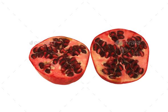 Isolated Pomegranate halves on white background - Stock Photo - Images