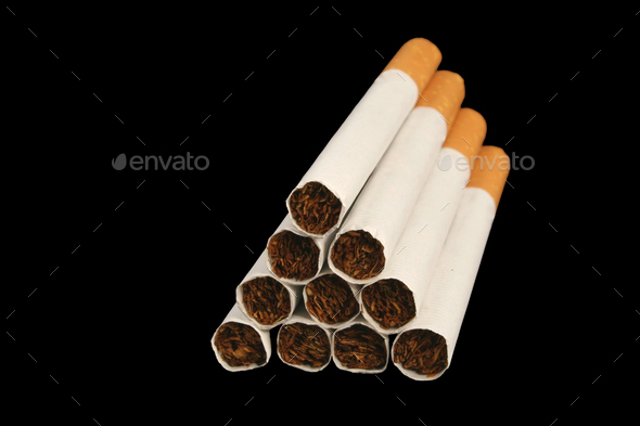 Isolated Cigarettes on a black background - Stock Photo - Images