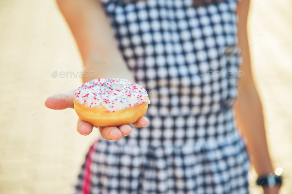Woman holding delicious donut. - Stock Photo - Images