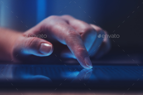 Extreme close up of female finger using digital tablet computer - Stock Photo - Images