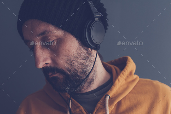 Man listening to music on headphones - Stock Photo - Images