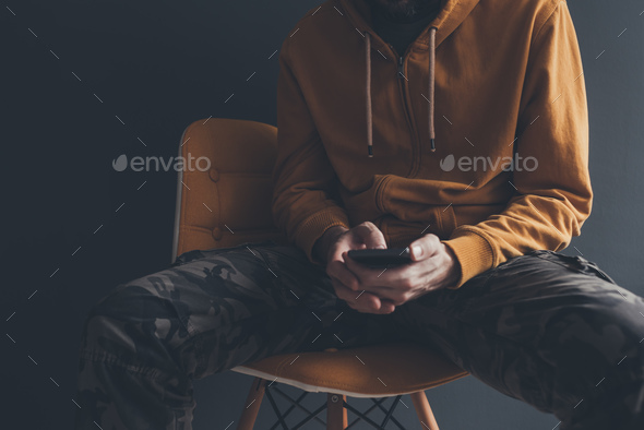 Casual man using smart phone - Stock Photo - Images