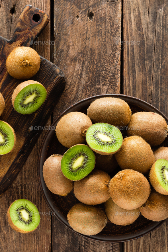 Kiwi fruit on wooden rustic table, ingredient for detox smoothie - Stock Photo - Images