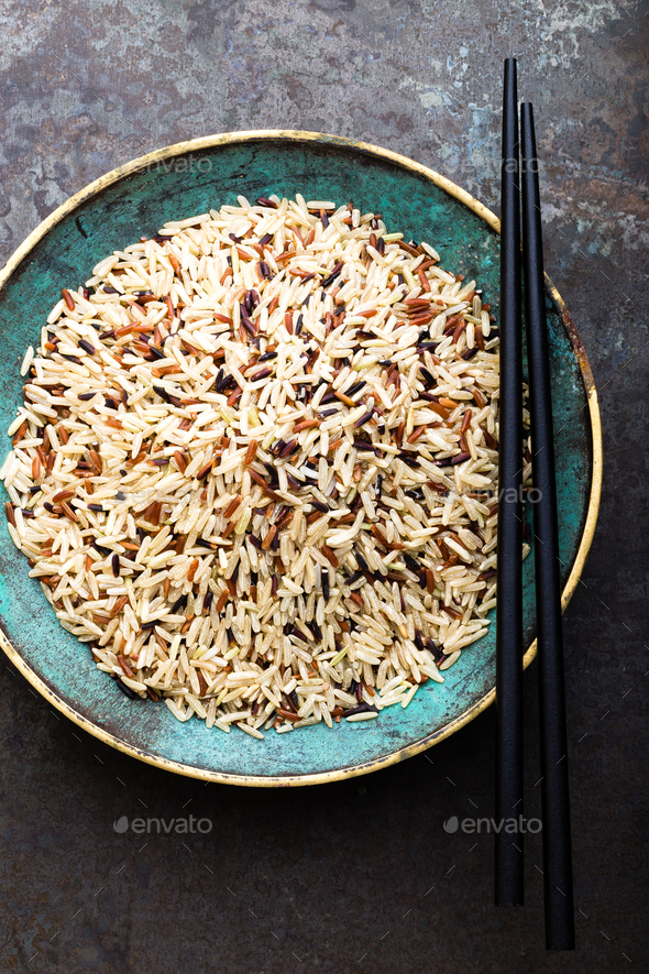 White, brown and black wild rice. Rice in bowl. - Stock Photo - Images