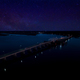 Aerial view of bridge at night with the milky way in the sky. - PhotoDune Item for Sale