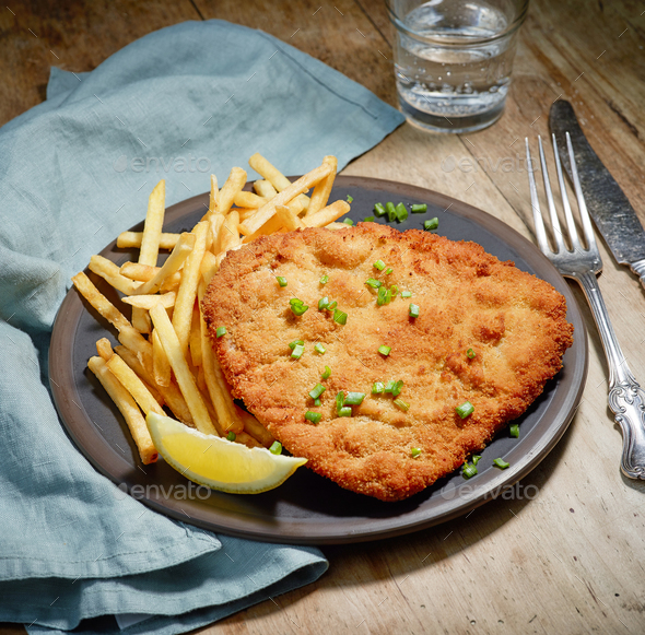 Weiner Schnitzel with fried Potatoes - Stock Photo - Images