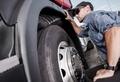Trucker Making Tire Check - PhotoDune Item for Sale