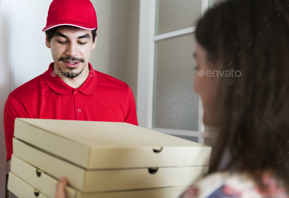 Man delivery pizza to customer - Stock Photo - Images