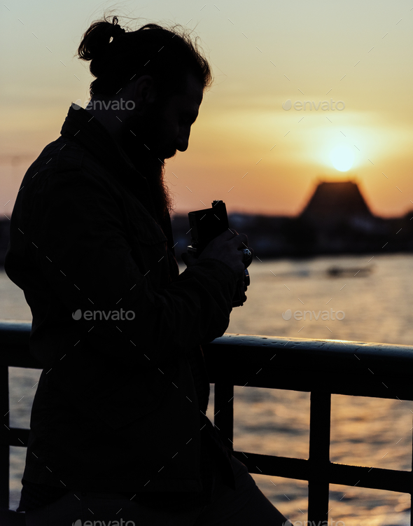 Silhouette of a photographer - Stock Photo - Images