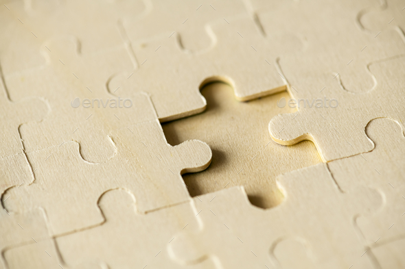 Macro shot jigsaw puzzle missing solution concept - Stock Photo - Images