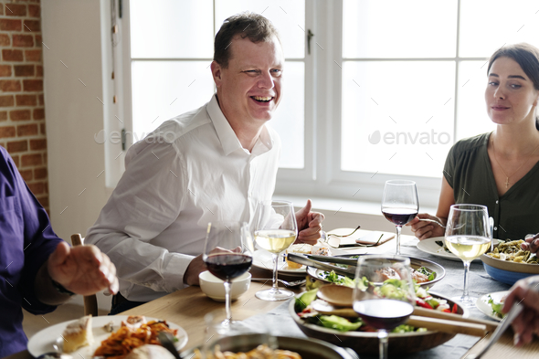Friends gathering having Italian food together - Stock Photo - Images