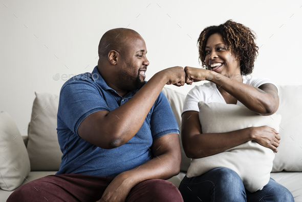 A cheerful black couple - Stock Photo - Images