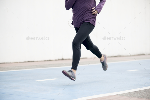 White woman running on track - Stock Photo - Images