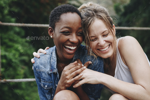 Happy friends holding each other - Stock Photo - Images