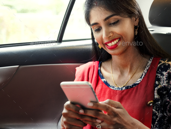 Indian woman using mobile phone - Stock Photo - Images