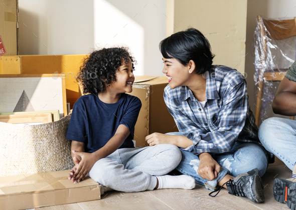 Black family moving to new house - Stock Photo - Images