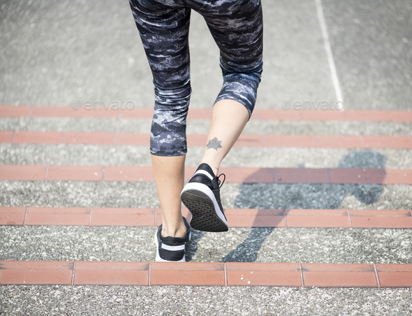 Woman walking down the stair - Stock Photo - Images