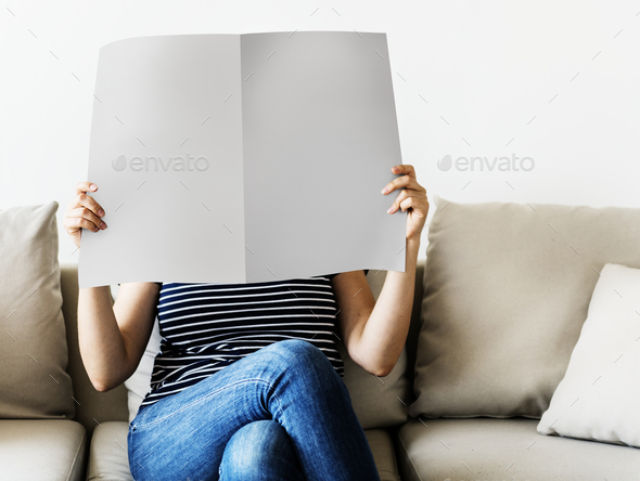 Woman reading newspaper - Stock Photo - Images
