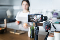 Female vlogger recording cooking related broadcast at home - PhotoDune Item for Sale