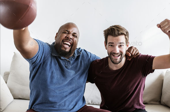 Men cheering sport together - Stock Photo - Images