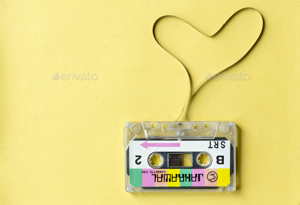 Cassette tape with a heart symbol isolated on yellow background - Stock Photo - Images