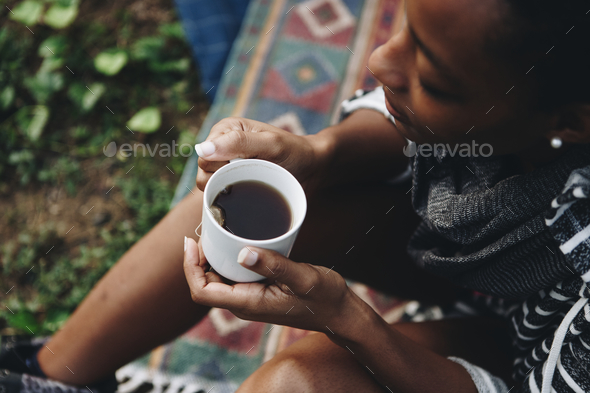 Woman enjoying morning coffee with nature - Stock Photo - Images