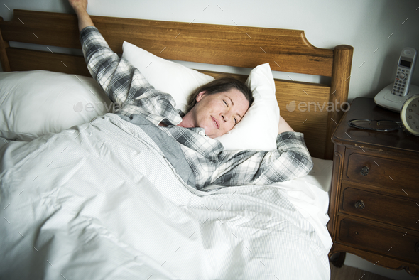A woman waking up - Stock Photo - Images