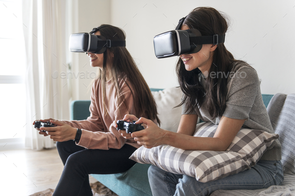 Women experiencing virtual reality with VR headset - Stock Photo - Images