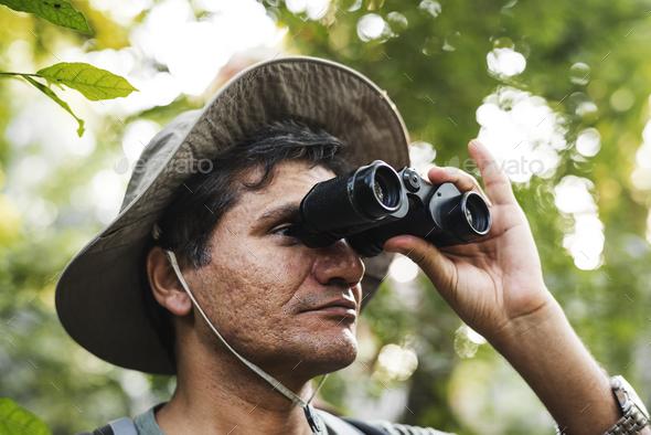 Man using binoculars - Stock Photo - Images