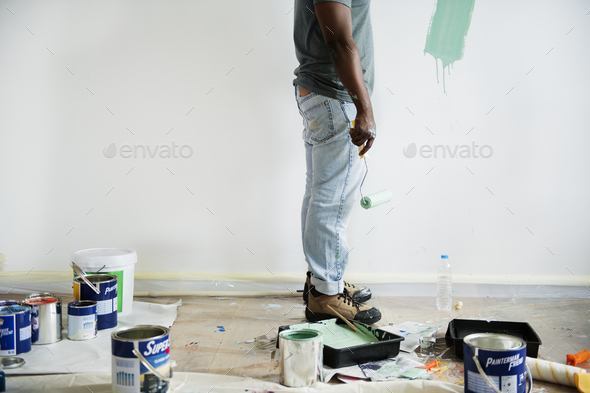 Black man painting house wall - Stock Photo - Images