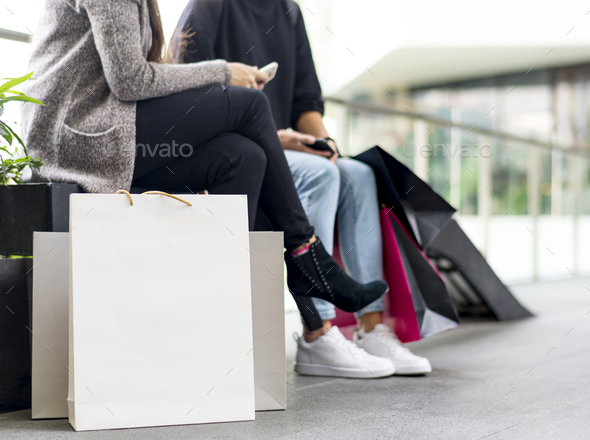 Women taking a break while shopping - Stock Photo - Images