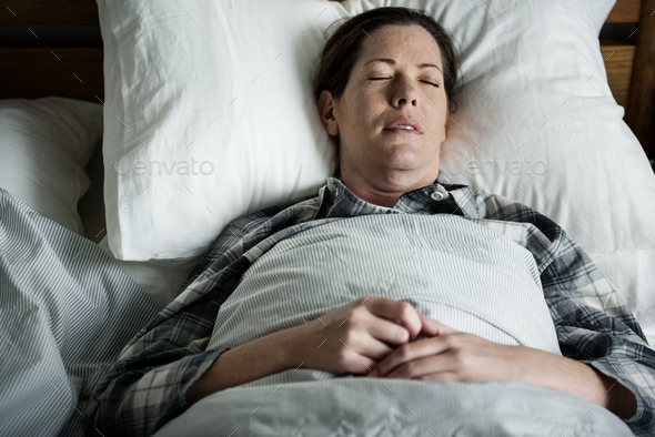 A woman sleeping soundly - Stock Photo - Images