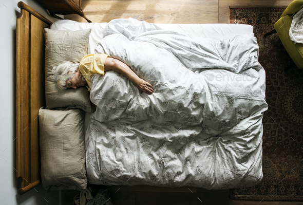 Elderly Caucasian woman sleeping on the bed - Stock Photo - Images