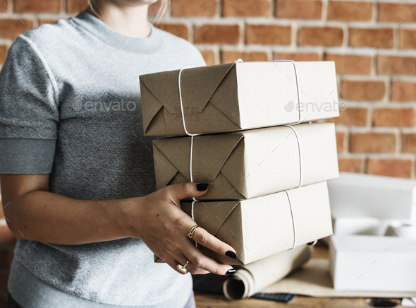 Woman working at parcel service - Stock Photo - Images