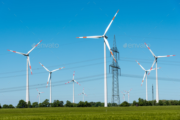 Power supply lines and wind turbines  - Stock Photo - Images