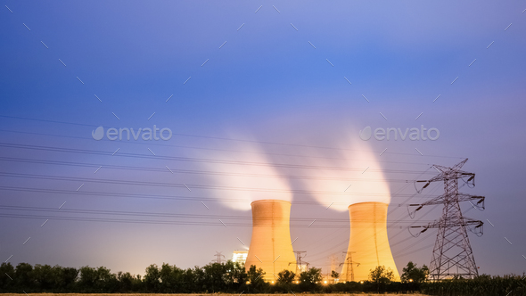 cooling tower of power plant at night - Stock Photo - Images