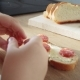 Little Child Making Sandwich with Butter and Sausage - VideoHive Item for Sale