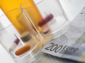 Some medicines along with a ticket of 200 euros, conceptual image copay health - PhotoDune Item for Sale