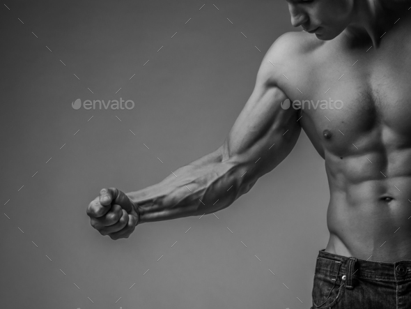 Muscular arm and torso - Stock Photo - Images