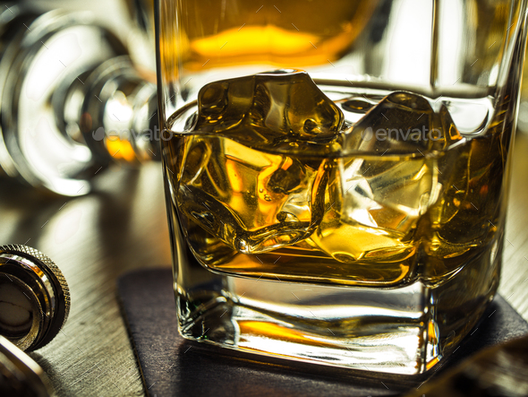 Whiskey on the rocks on a wooden table - Stock Photo - Images