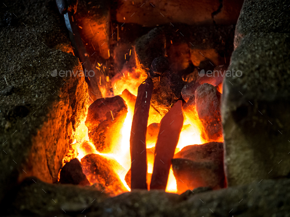 Blazing furnace at the blacksmith's - Stock Photo - Images