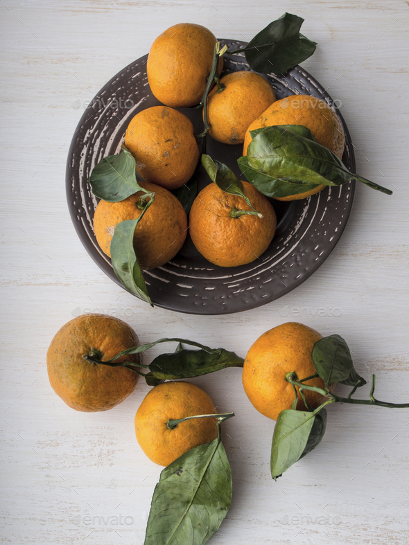 Fresh whole tangerines with leaves - Stock Photo - Images
