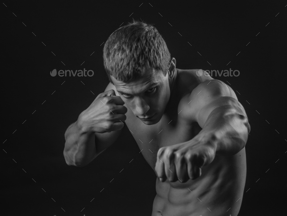 Young fit man shadow boxing - Stock Photo - Images