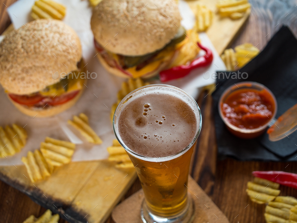 Freshly made burgers with crisps - Stock Photo - Images