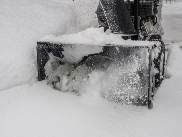 Snowblower at work on a winter day - Stock Photo - Images